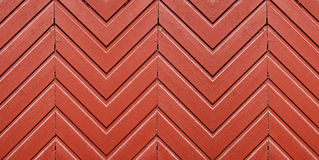 Red zigzag. Wooden panelling on a Finnish house Stock Images