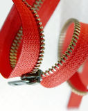 Red zipper on a white Royalty Free Stock Images