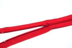 Red zipper on white background Stock Photo