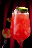 Red Zombie Cocktail. Zombie Cocktail - Dark and Light Rums, 151-proof Rum and Various Syrup, Grenadine, Grapefruit Juice, Lime Juice, Absinth and Cane Sugar Stock Photo