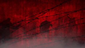 Red Zombies Behind the Wire. This video features a red foggy atmosphere with zombie silhouettes walking toward a panning camera view stock video footage