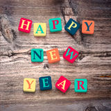 Redacta Feliz Año Nuevo con los bloques coloridos Foto de archivo