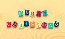 Redacta Feliz Navidad con los bloques coloridos Foto de archivo
