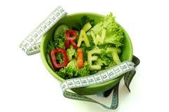 Redacta la dieta cruda integrada por las rebanadas de diversas verduras Foto de archivo libre de regalías
