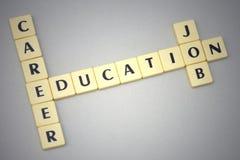 Redacta la educación, la carrera y el trabajo en un fondo gris Imagen de archivo libre de regalías