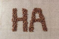 """Redacte """"ha"""" de los granos de café Foto de archivo"""