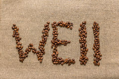 """Redacte """"well"""" de los granos de café Fotografía de archivo"""