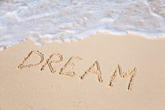 Redacte el SUEÑO en la playa - fondo del concepto de las vacaciones foto de archivo