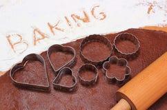 Redacte la hornada escrita en harina y pasta para las galletas Foto de archivo libre de regalías