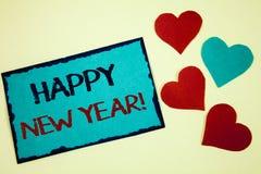 Redacte la llamada de motivación de la Feliz Año Nuevo del texto de la escritura Concepto del negocio para la nota de celebración Fotos de archivo libres de regalías