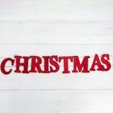 Redacte la Navidad hecha de las letras que brillan rojas puestas en el St Fotografía de archivo