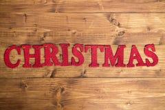 Redacte la Navidad hecha de las letras que brillan rojas puestas en el St Imagen de archivo libre de regalías