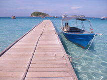 Redang Island. Jetty at Redang island in Malaysia with white sand, blue sky clear water Stock Photography