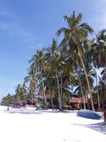 Redang Island. In Malaysia with white sand, blue sky, coconut trees in a row and outdoor sports area Royalty Free Stock Photo