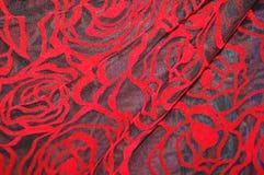 RedBlackRose. Red rose velvet on black mesh Royalty Free Stock Photos