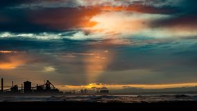 Redcar beach at sunset. Industrial background. royalty free stock photos