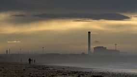 Redcar beach at sunset. Industrial background. stock image