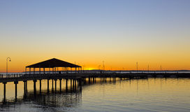 Redcliffe Jetty at Sunsire. Stunning view of the Redcliffe, Australia, jetty at sunrise royalty free stock images