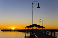 Redcliffe Jetty at Sunsire. Stunning view of the Redcliffe, Australia, jetty at sunrise stock images