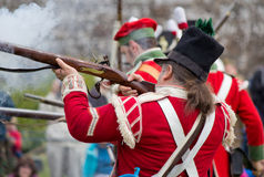 Redcoat soldier firing rifle stock photos