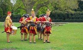 The Redcoats of  Pulteneys  Regiment loading their Muskets. SAFFRON WALDEN, ESSEX, ENGLAND - MAY 01, 2017:  The Redcoats of  Pulteneys  Regiment loading their Stock Photo