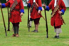 Redcoats with rifles standing to attention. Redcoats with rifles Royalty Free Stock Image