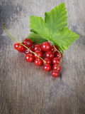 Redcurrant branch on old wooden table Stock Photos