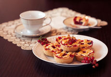 Redcurrant cupcakes. Summer dessert - redcurrant cupcakes and coffee Stock Image