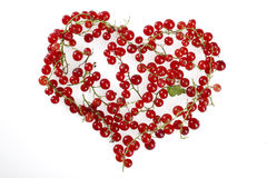 Redcurrant heart shape. Redcurrants shaped in a heart Royalty Free Stock Photos
