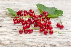 Redcurrant on old wooden surface close-up at selective focus Stock Photography