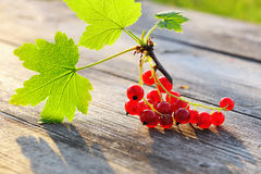 Redcurrant on wooden table Stock Photos