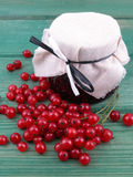 Redcurrants jam. Jar of redcurrants jam and some fresh currants stock images