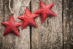 Redd Christmas tree decorations on grunge wood. Red Christmas tree decorations on grunge wood background. Winter holidays concept. Copy space for your text Stock Photo