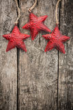 Redd Christmas tree decorations on grunge wood. Red Christmas tree decorations on grunge wood background. Winter holidays concept. Copy space for your text Royalty Free Stock Image