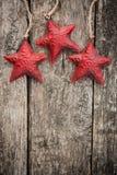 Redd Christmas tree decorations on grunge wood Royalty Free Stock Image