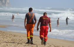 Redders op het strand Stock Foto