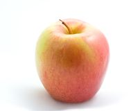 Reddish Apple. A photo of a reddish apple over a white background Royalty Free Stock Images