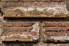 Reddish brown brick wall with plaster  Royalty Free Stock Photo