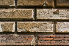 Reddish brown brick wall with plaster 1 Royalty Free Stock Photo