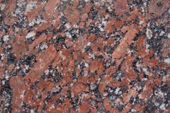 Reddish-brown granite texture with black and gray spots. Used as a background. Copy space for your text Royalty Free Stock Images
