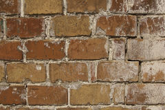 Reddish brown old brick wall. Textured background closeup Royalty Free Stock Photography