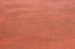 Reddish brown painted wood panel board with paintbrush texture.  Stock Photography