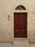 Reddish brown wood door in Malta Royalty Free Stock Image