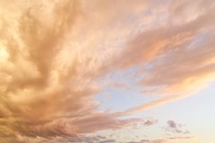 Reddish clouds in the sky in the evening. Just before sunset stock photography