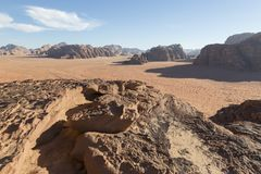 Reddish sand and rock landscapes in the desert of Wadi Rum Stock Photography