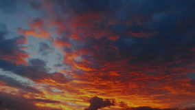 Reddish sunset. Painting the clouds and opaque Stock Photos