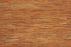 Reddish Thin Brick Wall. Background Stock Image