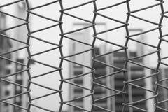 Rede de arame e arranha-céus Imagem de Stock Royalty Free