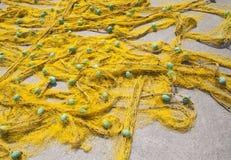 Rede de pesca amarela imagem de stock royalty free