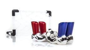 Rede do futebol com botas e bola Fotos de Stock Royalty Free